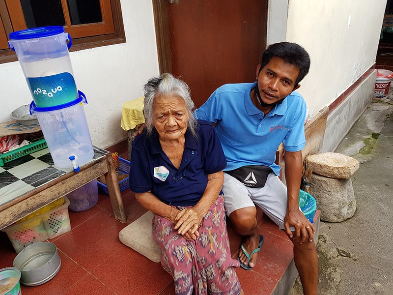 old woman receives water filter